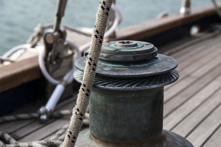 Bollard Cleat Close-up Day Focus On Foreground Metal Mode Of Transportation Moored Nature Nautical Vessel No People Outdoors Rope Sailboat Sea Strength Tied Up Transportation Water Wheel Wood - Material
