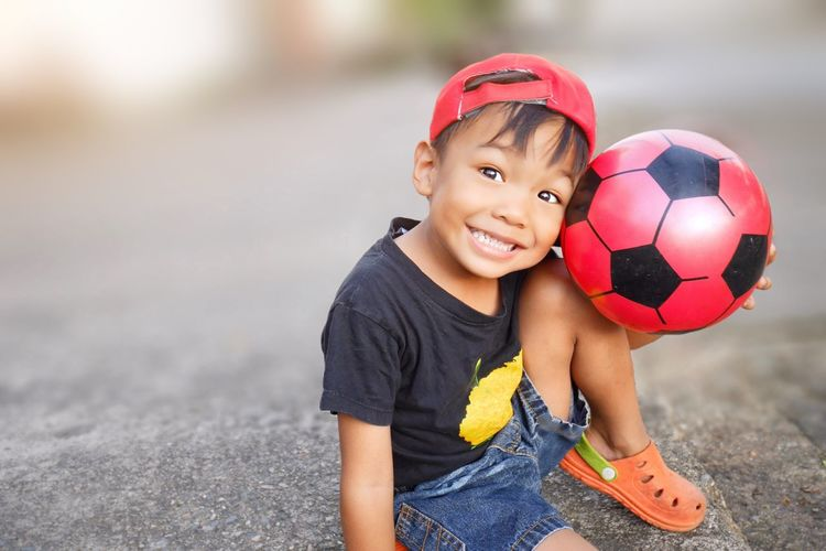 Sport Childhood Child One Person Ball Sport Offspring Looking At Camera Leisure Activity Happiness Real People Portrait Playing Day Innocence Boys Smiling Men Males
