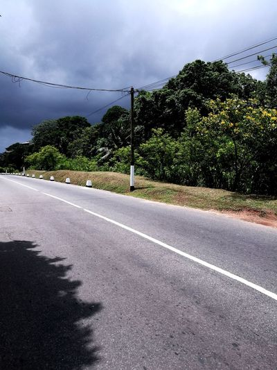 Storm Cloud Cloud - Sky Outdoors Day No People Sky Tree Rural Scene Scenics Nature Road Beauty In