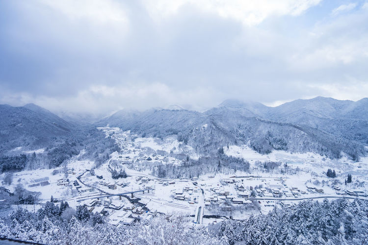 Winter Cloud - Sky Scenics - Nature Cold Temperature Mountain Snow Sky Beauty In Nature Landscape Environment Tranquil Scene Mountain Range Nature Architecture No People Tranquility Building Exterior Day Built Structure Outdoors Snowcapped Mountain TOWNSCAPE