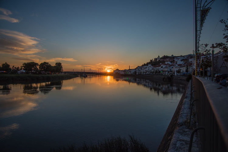 Sunset Alcácer do Sal, Alentejo, Portugal Alcacer Do Sal Alentejo Portugal Sky Sunset Water Reflection Cloud - Sky Beauty In Nature No People City Outdoors Scenics - Nature River Rio Sado Dramatic Sky Reflection Waterfront Panoramic