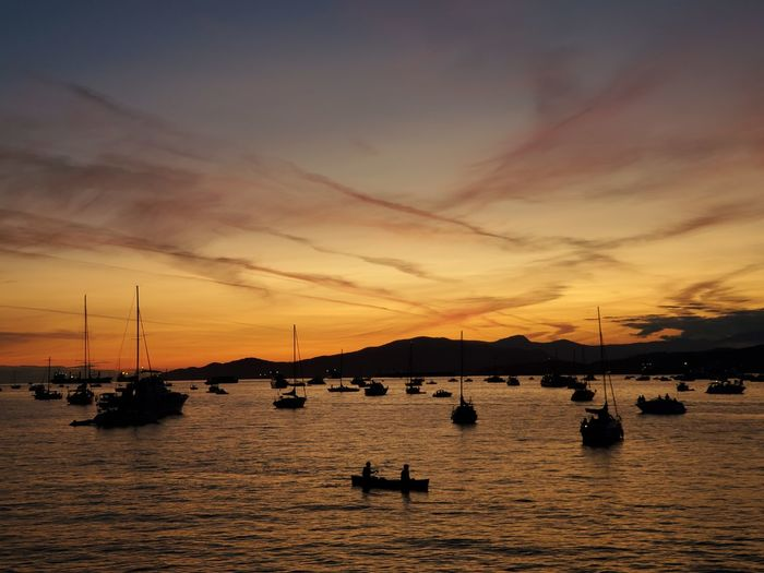 Boats in marina at sunset