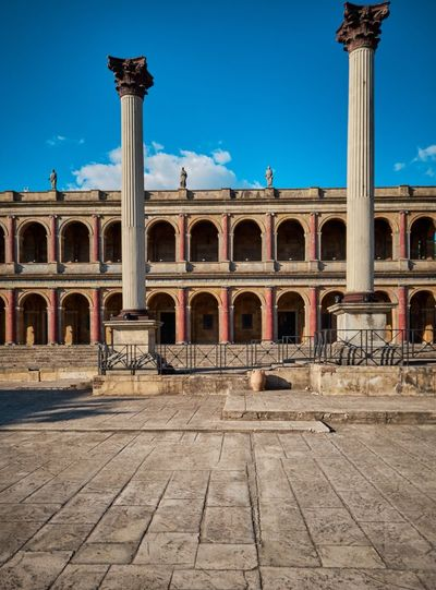 Cinecittà, Rome Ancient Ancient Civilization Arch Archaeology Architectural Column Architecture Blue Building Exterior Built Structure Colonnade Courtyard  Day History Nature No People Old Outdoors Ruined Sky Sunlight The Past Tourism Travel Travel Destinations