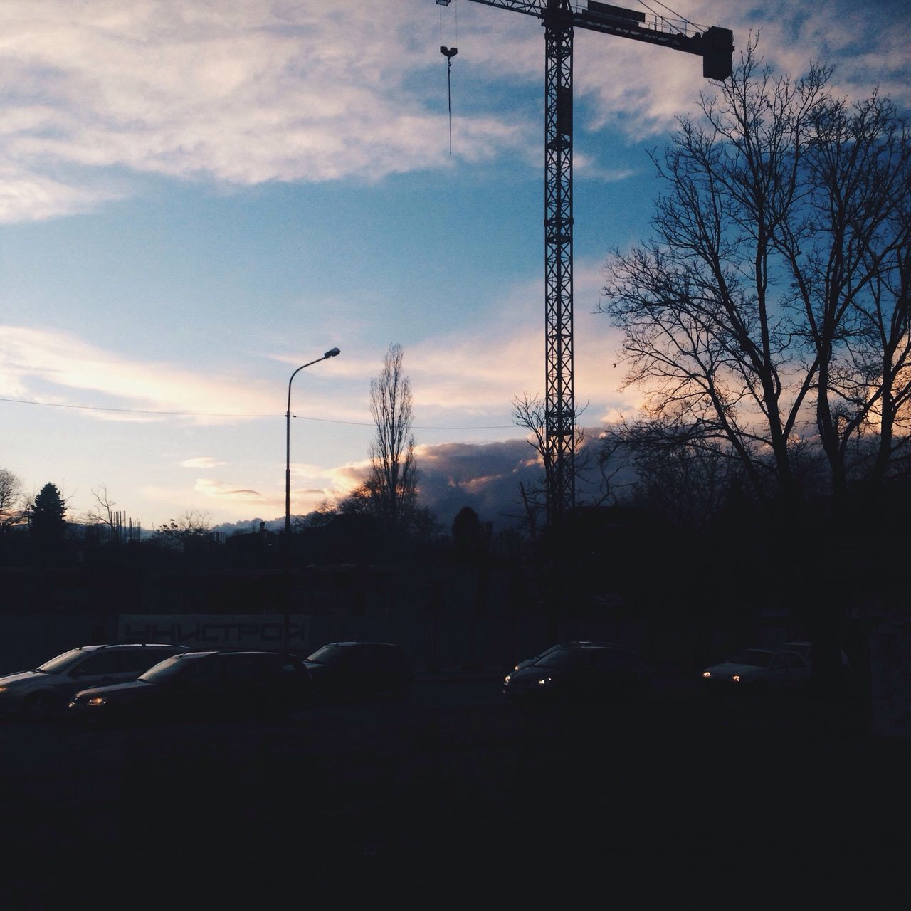 car, transportation, land vehicle, tree, sky, bare tree, cloud - sky, silhouette, street light, no people, outdoors, day