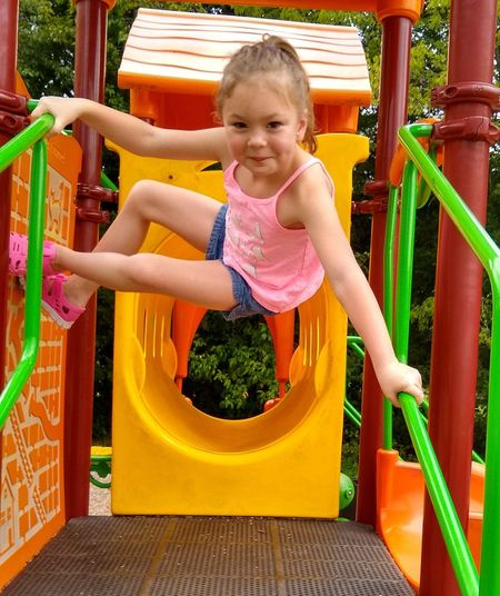Smiling girl playing in park
