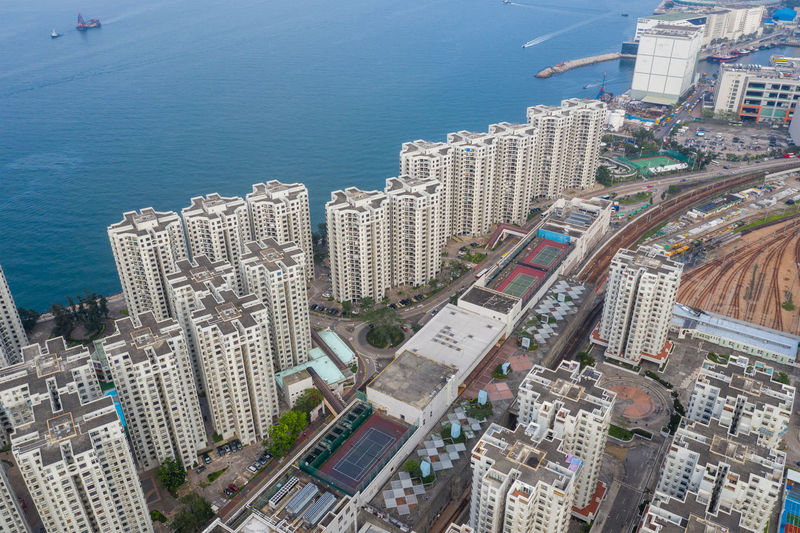 High angle view of buildings and sea in city