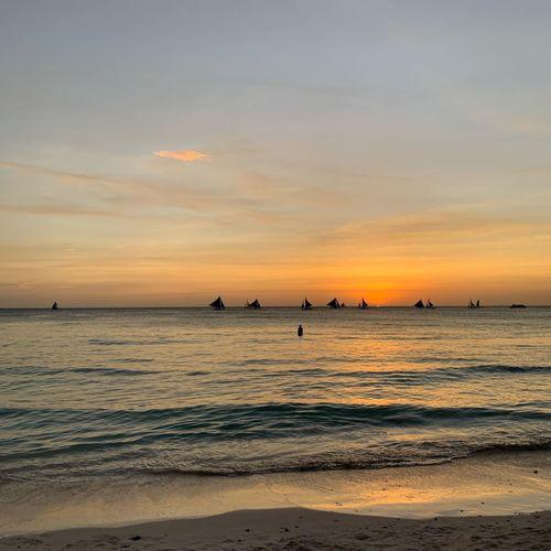 Paraw Sunset Islandlife Travel EyeEm Selects Sunset Water Sea Sky Beach Land Scenics - Nature Beauty In Nature Horizon Over Water Tranquility Tranquil Scene Outdoors Non-urban Scene Idyllic Sand Horizon Orange Color Nature Cloud - Sky