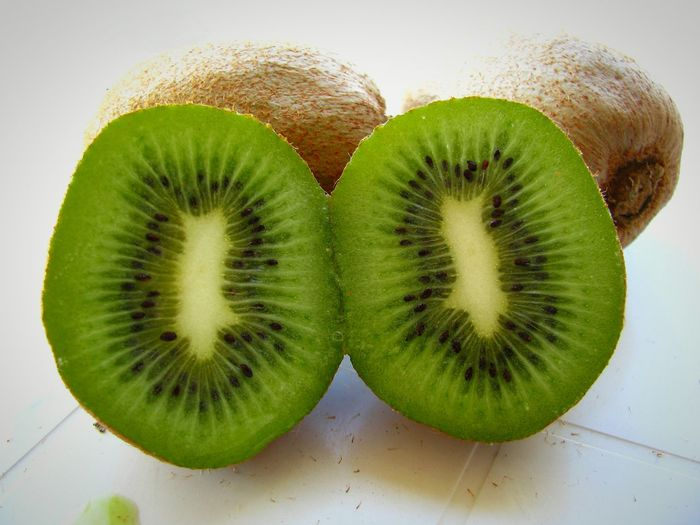 Kiwi Kiwi - Fruit Kiwis Fruit Green Color Backgrounds Fine Art Dietfood Diet & Fitness Diet Green Green Fruit Food Close-up Food And Drink Healthy Eating Freshness Ready-to-eat Nutritious Delicious Still Life White Background My World Of Food Food Photography Healthy Food Visual Feast Food Stories