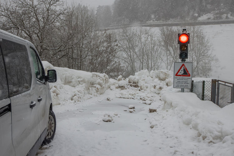 Road sign on snow covered street