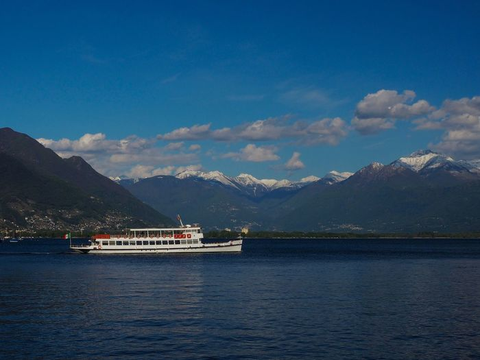 Passenger ferry leaving Locarno on Lago Maggiore Beauty In Nature Cloud - Sky Day Lake Mountain Mountain Range Nature Nautical Vessel No People Outdoors Scenics Sky The Great Outdoors - 2017 EyeEm Awards Tranquil Scene Tranquility Transportation Water Waterfront