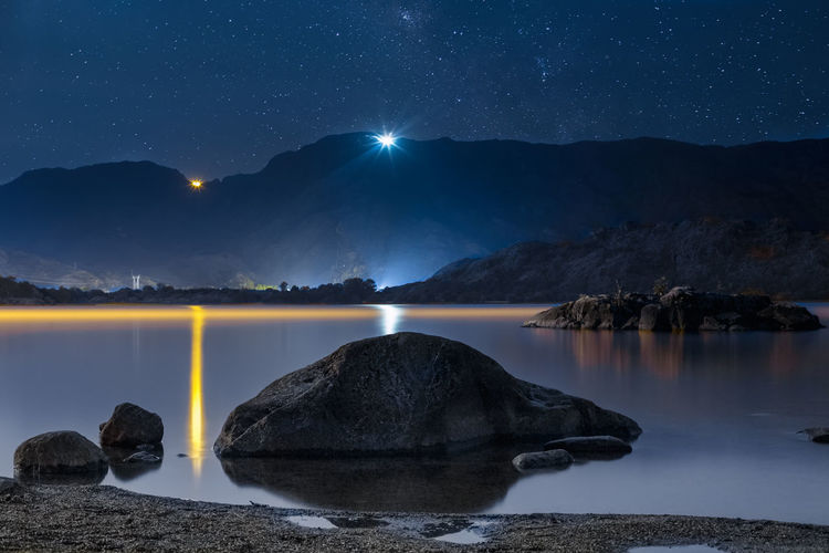 Night sky stars over mountain lake. Summer starry night Beautiful Dark Galaxy Nature Nightphotography Reflection Travel Adventure Beauty Blue Forest Lake Landscape Milky Way Mountains Mountains And Sky Night River Scene Sky Star Starry Summer Tranquil Scene Water