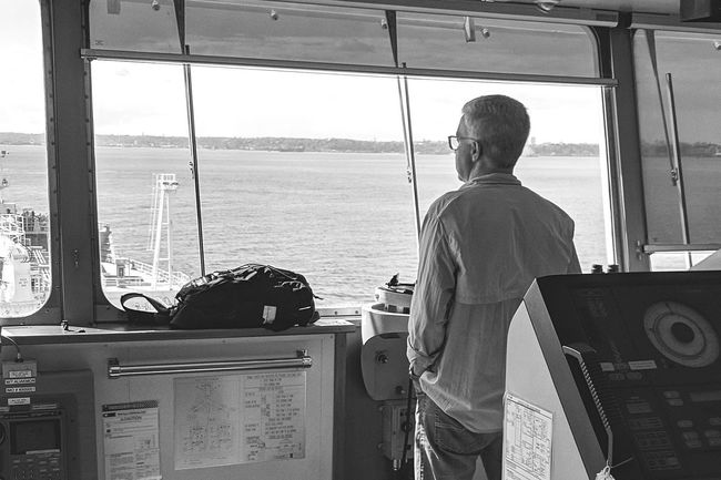 Nautical Theme Nautical Vessel Cargo Ship Life Onboard Politics And Government Standing Men Working Occupation Sky One Senior Man Only Senior Men Working Seniors Active Seniors Senior Adult Boat Captain Hands In Pockets