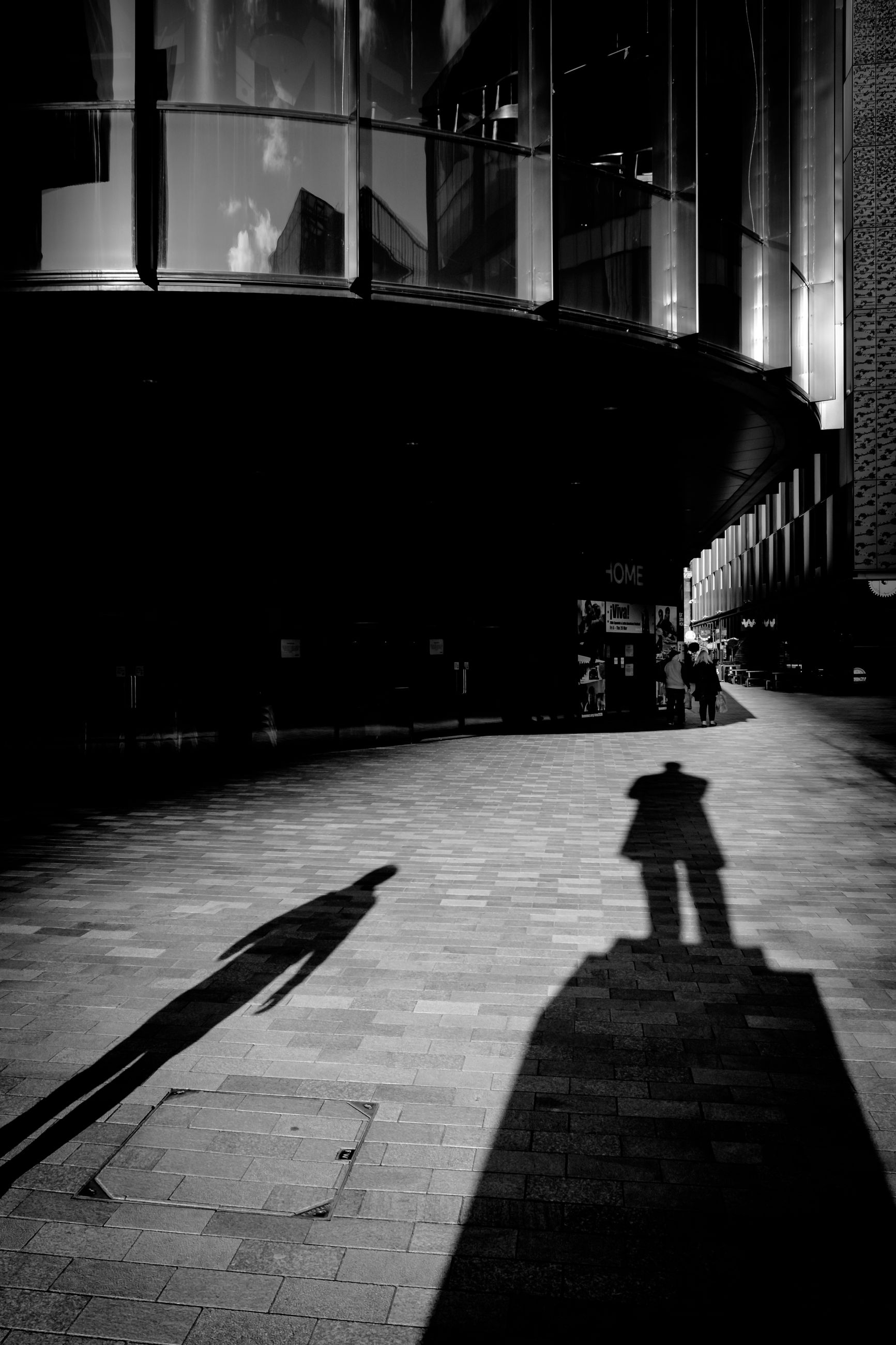 shadow, architecture, built structure, night, city, one person, real people, building exterior, walking, street, lifestyles, nature, unrecognizable person, illuminated, silhouette, outdoors, incidental people, footpath, focus on shadow