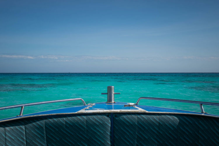 Boat Sailing In Sea Against Clear Blue Sky