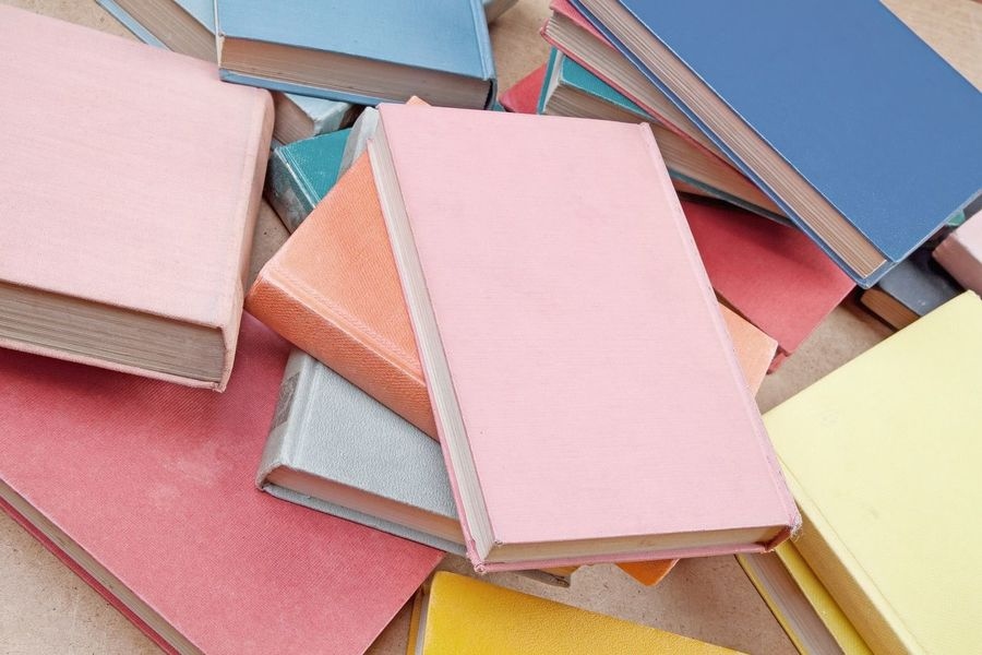 Several old books Used Retro Styled A Lot Of Objects Nobody No Persons Book Cover Covers Red Blue Learning School Reading Knowledge Stack Several Pastel Colors Hard Cover  Books No People Pink Color Indoors  Paper Close-up Day