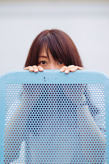 now you see me... Asian Girl Blue Casual Clothing Close-up Cute Eyes Eyes Are Soul Reflection Girl Girls Headshot Hiding Leisure Activity Lifestyles Pattern Portrait Relaxation Resting Textures And Surfaces