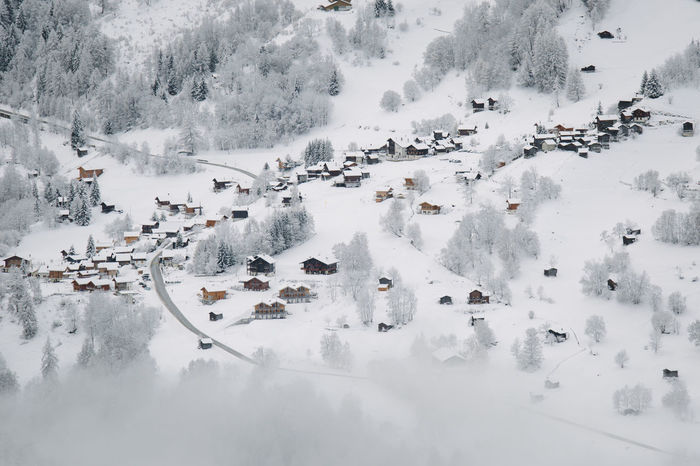 Aerial view of a mountain village located in the Val d'Anniviers, canton of Valais, Switzerland. Alps Beauty In Nature Cold Temperature Day Fog Frozen High Angle View Landscape Mountain Nature No People Outdoors Scenics Snow Swiss Alps Switzerland Tranquility Tree Val D'Anniviers Village Water Weather Winter