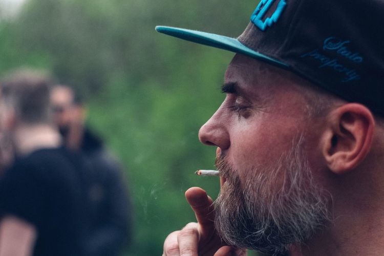 Smoking - Activity Real People Addiction Close-up Outdoors Army Day Young Adult Adult People EyeEm Best Shots Fujifilm_xseries Portrait The Portraitist - 2017 EyeEm Awards