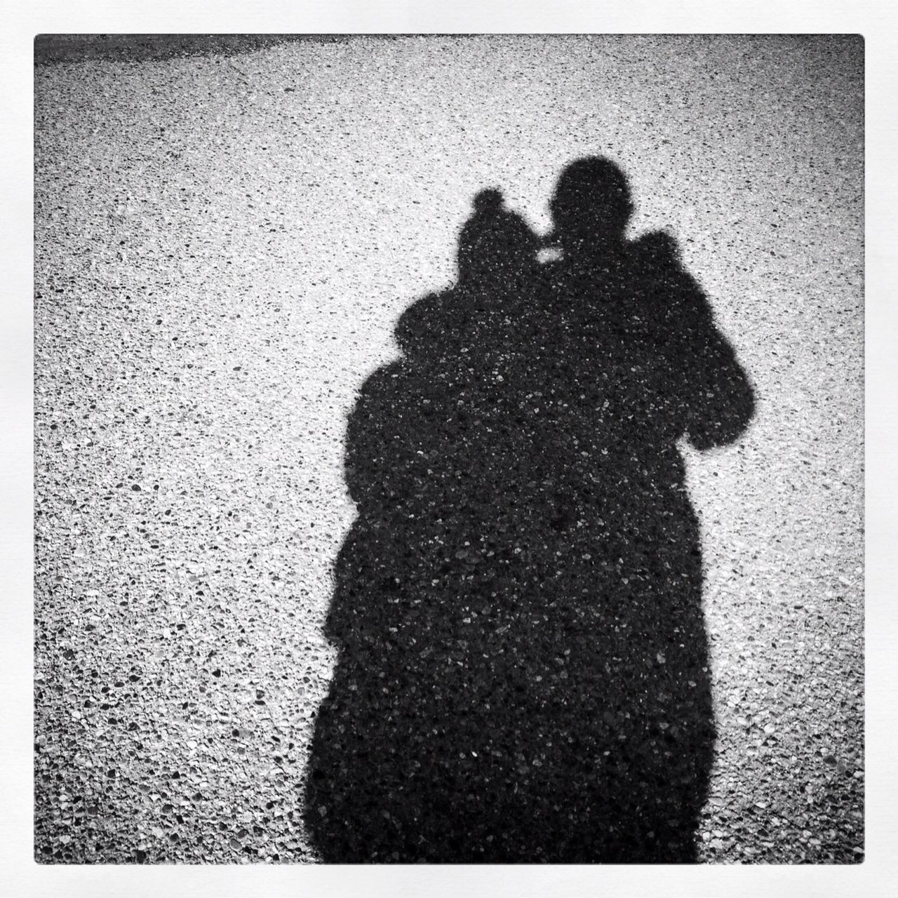 shadow, focus on shadow, two people, togetherness, love, real people, men, sunlight, day, high angle view, standing, silhouette, outdoors, couple - relationship, bonding, beach, people