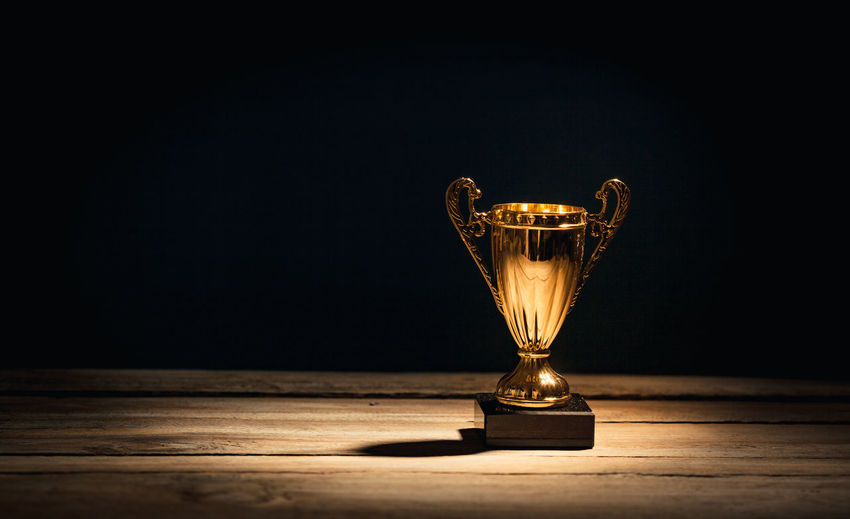 Achievement Awards First Hot Leader Smoke Smoking Trophy Waiting AWARD Competition Cup Distant Gold Illuminated Leadership Mist Reward Sports Studio Shot Success Table Winner Wood - Material