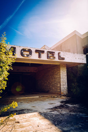 Abandoned Motel Against Sky In Sunny Day