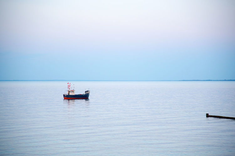 Water Nautical Vessel Sea Transportation Horizon Horizon Over Water Mode Of Transportation Sky Tranquility Travel Tranquil Scene Scenics - Nature Nature Day Clear Sky Blue Beauty In Nature Outdoors Trip No People
