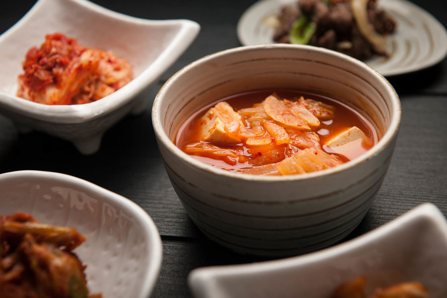 Korean Cuisine Asian Cuisine Korean Cuisine Korean Food Side Dish Tapas Asian Food Bowl Food Food And Drink Freshness Healthy Eating Kimchi Soup Ready-to-eat Serving Size Still Life Table