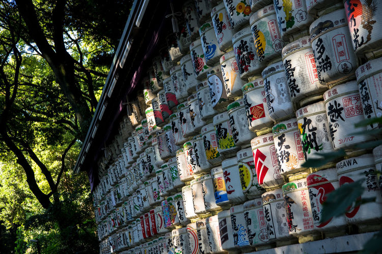 Sake barrels display Sake Sake Barrels Architecture Building Exterior Built Structure Day Low Angle View Multi Colored No People Outdoors Text Tree