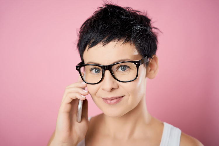 Portrait Headshot Looking At Camera Eyeglasses  Glasses Colored Background Studio Shot One Person Pink Background Front View Indoors  Young Adult Beauty Close-up Smiling Pink Color Beautiful Woman Adult Hair Body Part Hairstyle Human Face