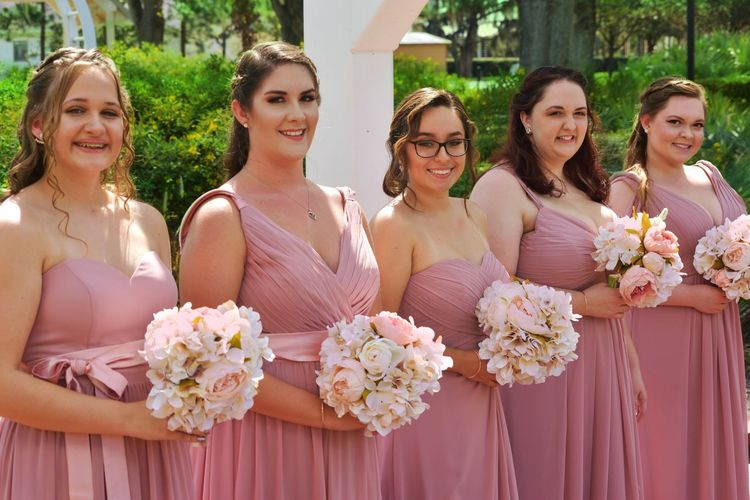 Bridesmaid Bridesmaid Dress EyeEm Selects Flower Bouquet Bride Wedding Dress Wedding Togetherness Life Events Smiling Wedding Ceremony Happiness Celebration Looking At Camera Cheerful Young Adult Wife Outdoors Day Standing Friendship Beginnings