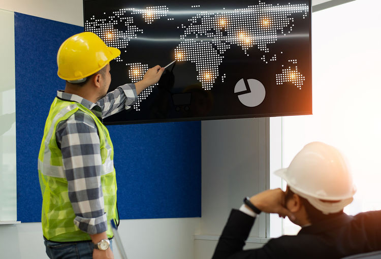 Headwear Occupation Hardhat  Helmet Hat Working Men Males  Adult People Safety Protection Indoors  Standing Young Men Communication Clothing Business Technology Design Professional ARCHITECT Engineering Business Finance And Industry Element World Map Globe Earth Architecture