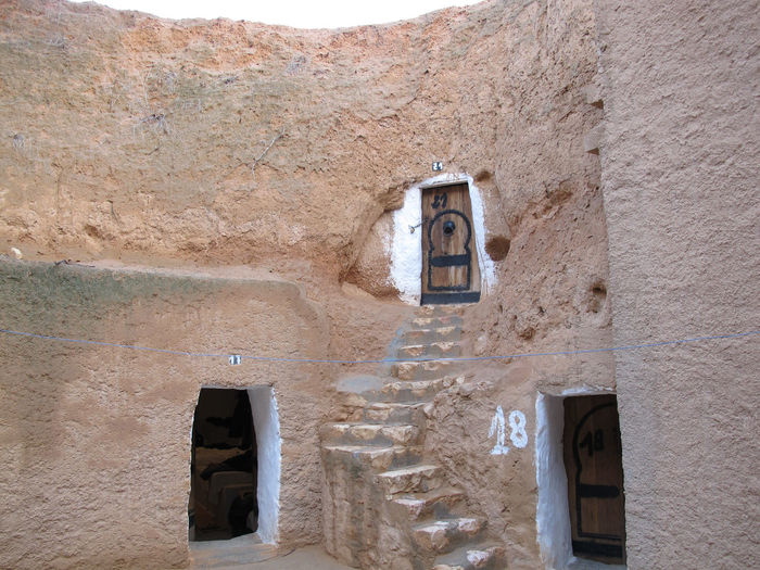Tunisia Traditional houses, holidays Architecture Built Structure Building Exterior No People Day Low Angle View Building Old Wall - Building Feature Wall Nature Outdoors Window Sunlight Damaged Solid History Communication Technology Connection Stone Wall