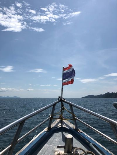 Speedboat on the sea Sky Water Nature Cloud - Sky Railing Flag Day Patriotism Scenics - Nature Beauty In Nature Architecture Sea Transportation Built Structure Tranquil Scene Outdoors Tranquility No People
