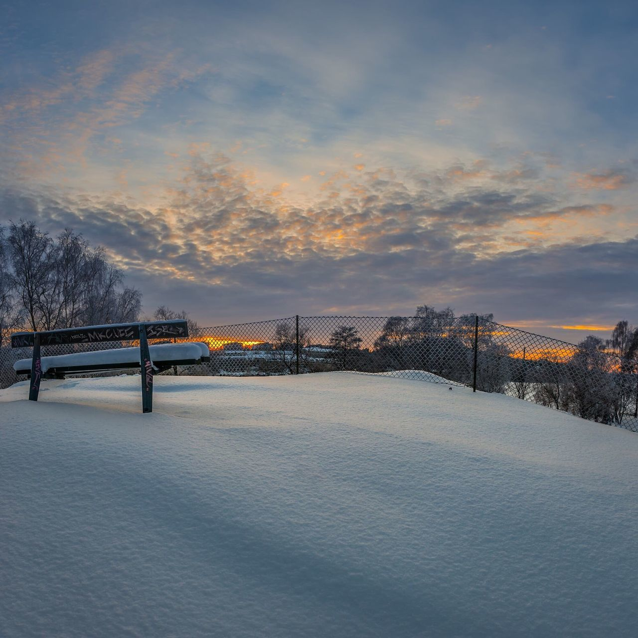 winter, cold temperature, snow, weather, sunset, bridge - man made structure, sky, nature, ice, frozen, architecture, outdoors, built structure, beauty in nature, no people, scenics, cloud - sky, landscape, ice-skating, building exterior, tree, day, city, ice rink