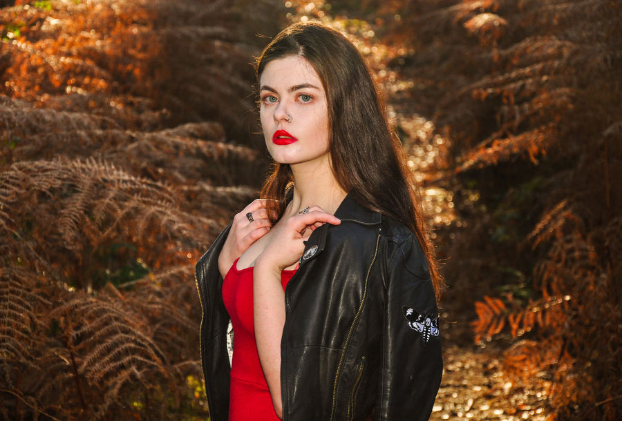 Beautiful young lady in a red dress in the forest Girl Millenial Young Lady Red Dress Red Red Color Red Lipstick Forest Trees Beauty Beautiful Woman Beautiful Long Hair Portrait Portrait Of A Woman Portrait Photography Ferns Bracken Black Leather Jacket Stunner Beautiful Young Lady Beautiful Young Woman Autumn Autumn colors autumn mood One Person Young Adult Hairstyle Hair Women Fashion Clothing Young Women Standing Waist Up