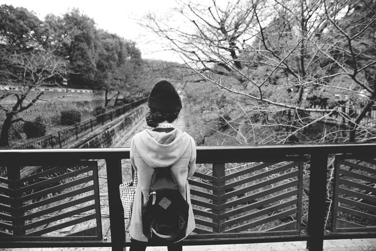 Rear view of girl on railing
