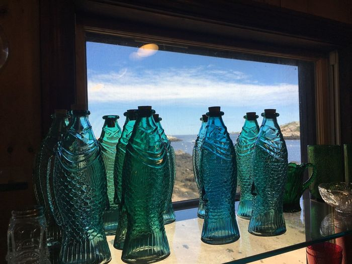 Bottles On Table By Device Screen