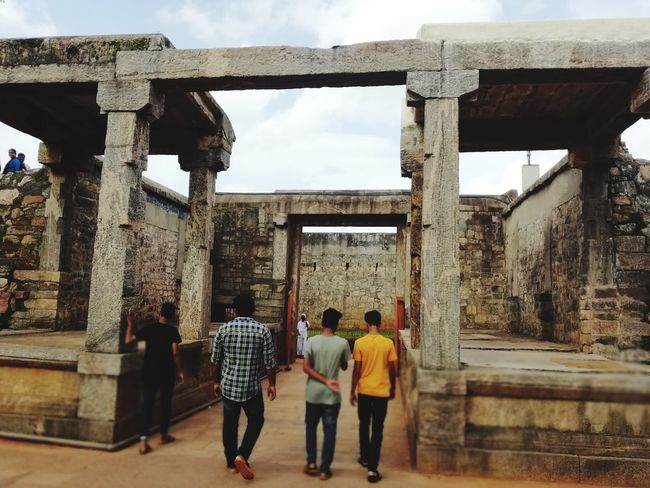 Tippu's Fort entrance Art Men City Sky Architecture Built Structure Building Exterior Scaffolding Construction Frame Girder Electrical Grid Roof Beam High Voltage Sign Oxfordshire Construction Material Building - Activity Building Contractor Construction Equipment Incomplete Construction Worker Construction Site Construction Worker Medium Group Of People Friend Window Washer Rear View The Traveler - 2018 EyeEm Awards