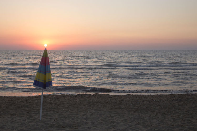 Holiday Beach Beauty In Nature Flag Horizon Horizon Over Water Land Motion Nature Orange Color Outdoors Sand Scenics - Nature Sea Sky Sunset Tranquil Scene Tranquility Water Wave HUAWEI Photo Award: After Dark