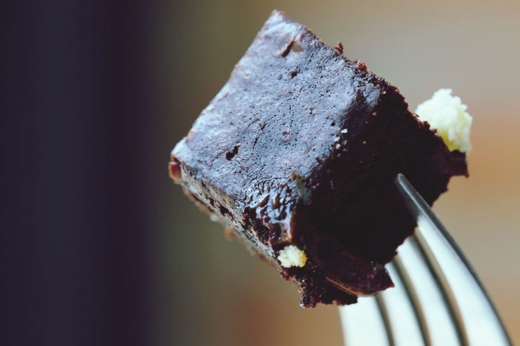 Close-up of fork with brownie