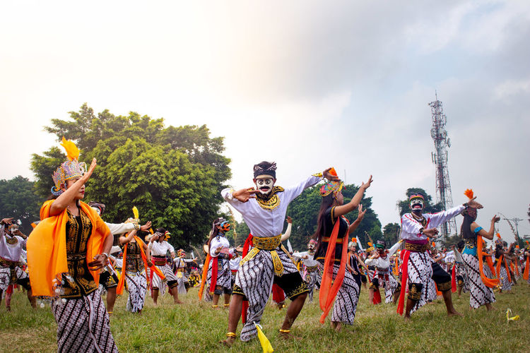 Colossal topeng dance performed by thousands of dancers in the wonosobo square
