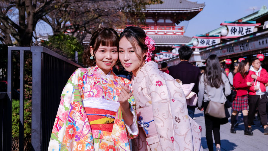 Portrait of a smiling young couple standing  with traditional japanese cloth called kimono