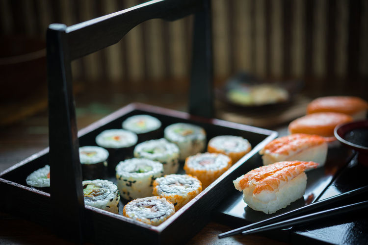 Close-Up Of Sushi In Plates On Table