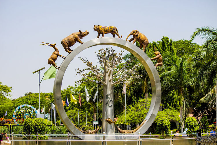 Entrance to Hyderabad Nehru Zoology Park Animal Themes Best Zoo Circle Hyderabad Zoo Hyderabad,India Hyderabaddiaries Low Angle View Nature Nehru Zoological Park Hyderabad Nehru Zoology Park NehruZooPark No People Outdoors Palm Tree Place To Visit Sculpture Sky Telanganatourism Zoo Park Hyderabad
