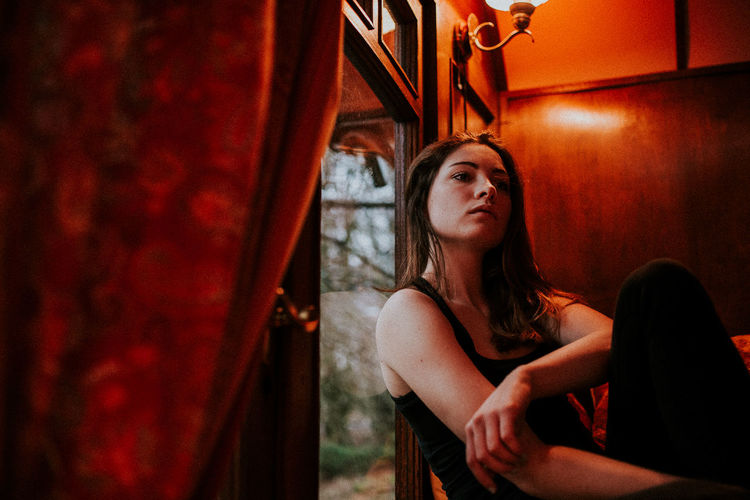 Artificial Light Beautiful Woman Daylight Illuminated Indoors  Indoors  Inside Lonely Low Angle View Melancholy Portrait Rainy Days Red Sadness Sitting Skin Thinking Warmth Without You Young Women