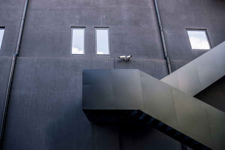 High angle view of bird perching on modern building