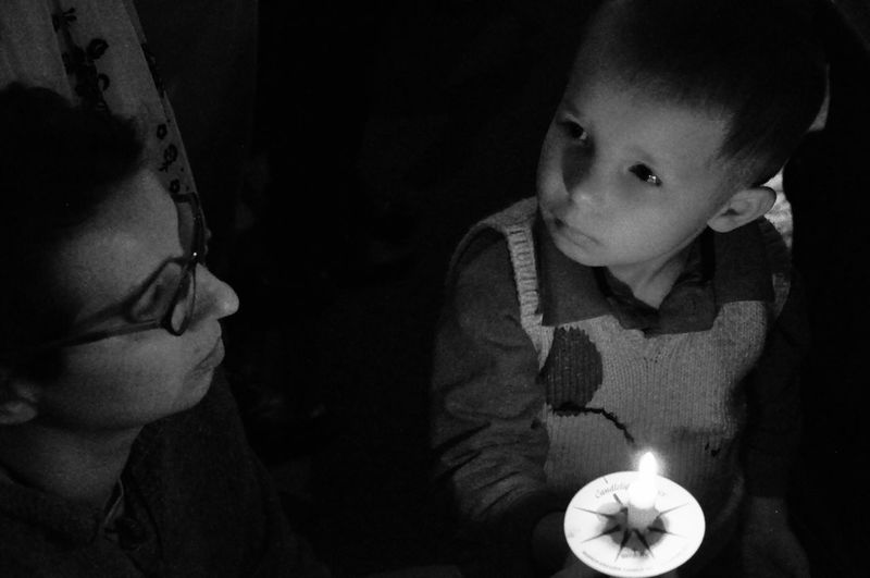 Enlightened Candle Real People Indoors  Lifestyles Child Illuminated Women Leisure Activity Childhood Burning Candle Glowing Innocence Fire Dark Looking Front View The Photojournalist - 2018 EyeEm Awards The Portraitist - 2018 EyeEm Awards The Street Photographer - 2018 EyeEm Awards HUAWEI Photo Award: After Dark
