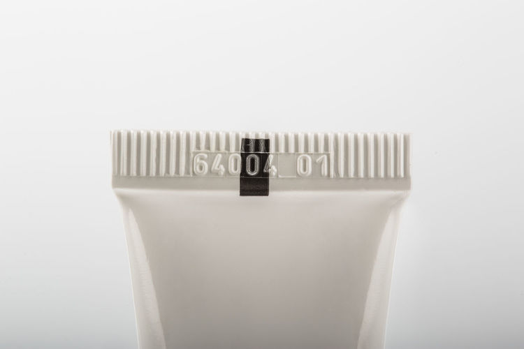 Close-up of electric lamp over white background