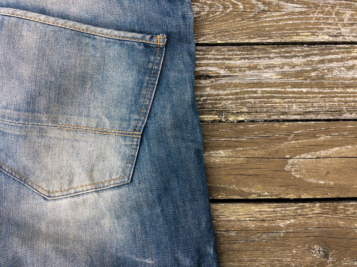High Angle View Of Jeans On Table