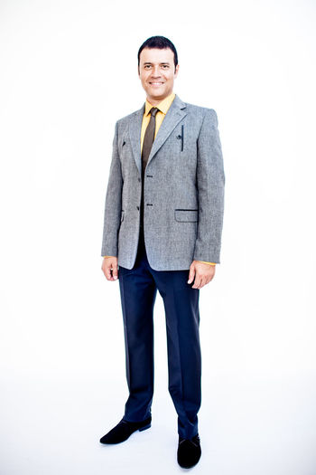 Man in classic suit on the white background. Studio shot. Business Business Stories Suit Business Finance And Industry Businessman Clothes Clothing Confidence  Formalwear Front View Full Length Full Suit Indoors  Looking At Camera Males  Men One Person Portrait Smiling Standing Studio Shot Well-dressed White Background Young Adult Young Men